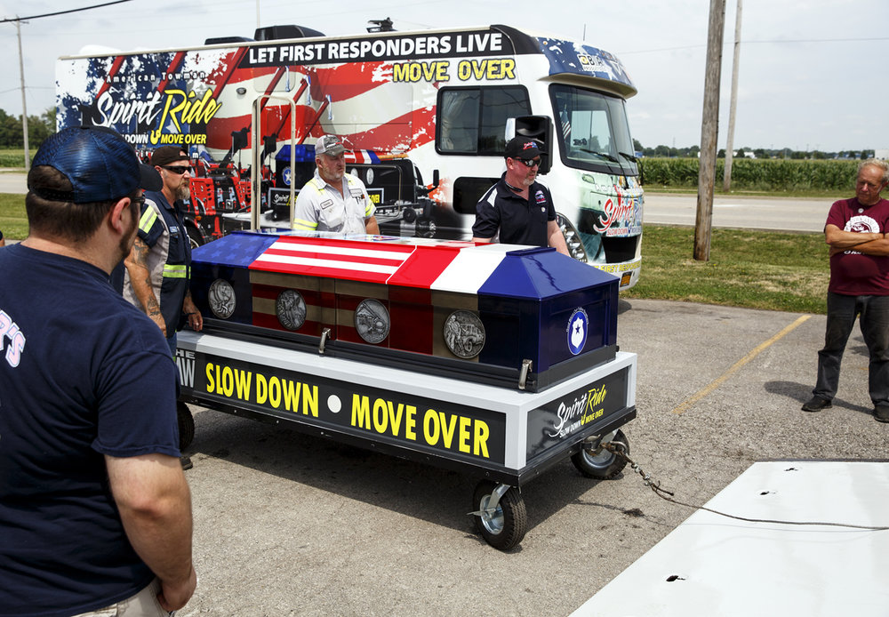 Employees of Shaner's Towing load a ceremonial casket onto a tow truck during an event to raise awareness for Slow Down, Move Over laws Tuesday, July 11, 2017 at Shaner's on North Dirksen Parkway. The Spirit Ride utilizes 250 towing companies across the country to relay the casket from coast to coast in an effort to bring more attention to the law that protects first responders and others on the scene of highway accidents. In September 2015, Jamal Horvath, 22, a tow truck operator from Rochester working to remove a disabled vehicle from the shoulder of Interstate 55 in Logan County, was hit and killed by a passing tractor-trailer. [Rich Saal/The State Journal-Register]