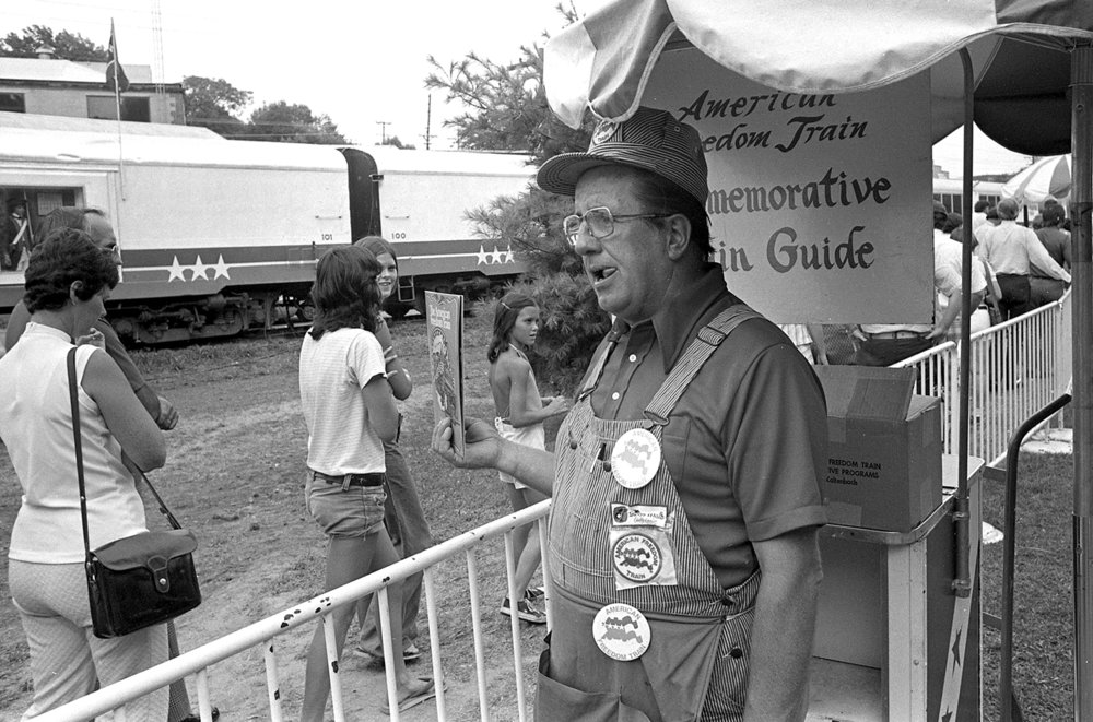 Bob Mullens sells souvenir programs for the American Freedom Train on its stop in Springfield July, 1975. File/The State Journal-Register