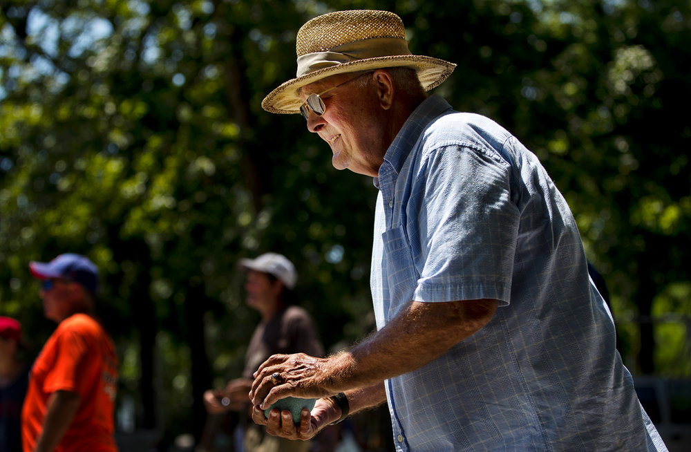 Philip Steele prepares to throw his bocce ball during the 2017 William Schrek Bocce Open at the Anchor Boat Club Sunday, July 16, 2017. The inaugural event was named in honor of Schrek, a former president of the club who was instrumental in getting the regular Thursday night games started. [Ted Schurter/The State Journal-Register]