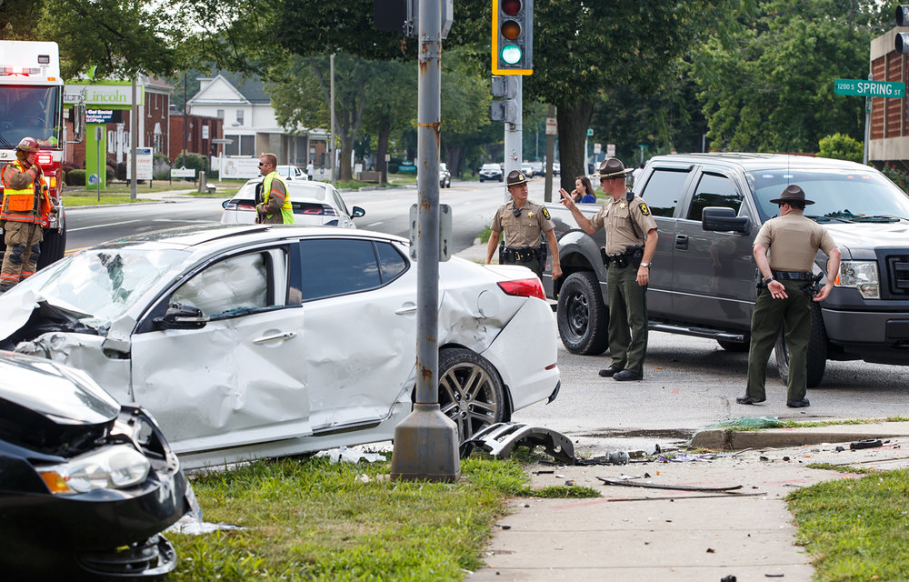 The Illinois State Police and the Springfield Fire Dept. work the scene of a four vehicle crash following a police chase with the white Kia sedan, center, at the intersection of South Grand Avenue and South Spring Street, Wednesday, July 19, 2017, in Springfield, Ill. [Justin L. Fowler/The State Journal-Register]