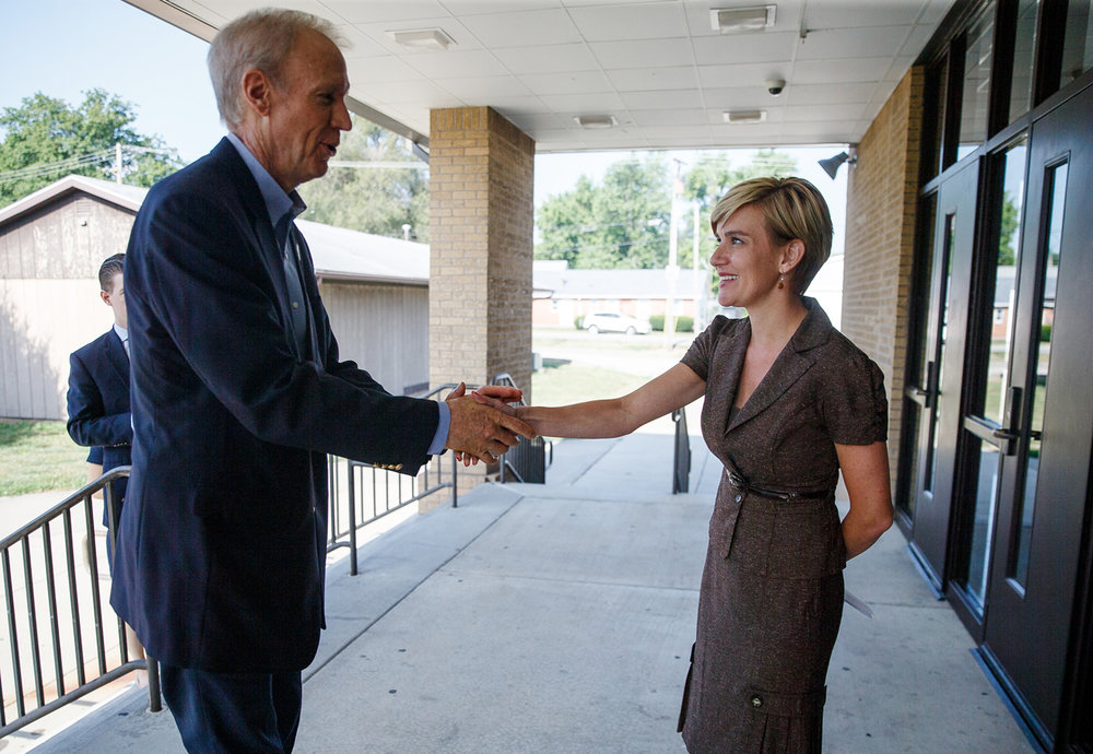 Illinois Gov. Bruce Rauner, left, is greeted by Illinois State Rep. Sara Wojcicki Jimenez, R-Leland Grove, right, outside of Auburn High School prior to holding a press conference about the school funding reform bill, Friday, July 21, 2017, in Auburn, Ill. [Justin L. Fowler/The State Journal-Register]