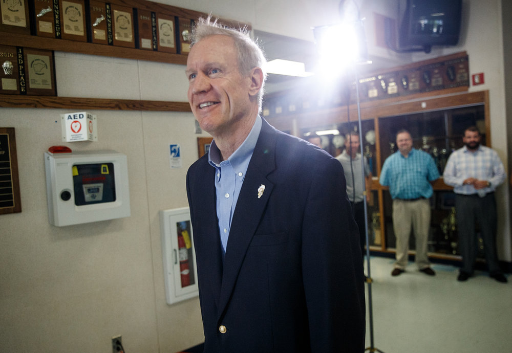 Illinois Gov. Bruce Rauner heads to the microphones to hold a press conference about the school funding reform bill at Auburn High School, Friday, July 21, 2017, in Auburn, Ill. Gov. Bruce Rauner said he will call lawmakers back into special session if a school funding reform bill isnÕt on his desk by noon on Monday. [Justin L. Fowler/The State Journal-Register]