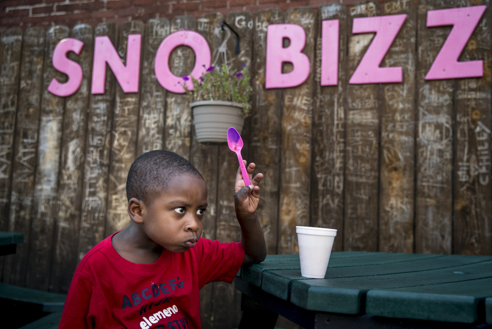 Isaiah Ford, 3, navigates the possibilities of a brain freeze after taking a big gulp of his shaved ice while trying to beat the heat with his family with a visit to Sno Bizz on West Laurel Street, Friday, July 21, 2017, in Springfield, Ill. The heat wave across the area will continue as the excessive heat warning has been extended into Sunday until 8 p.m. [Justin L. Fowler/The State Journal-Register]