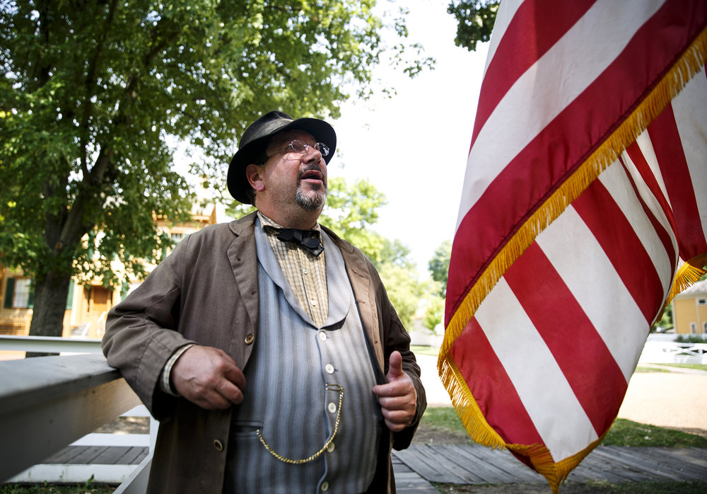 Living history presenter Hobie Woolen wears woolen trousers and three layers while volunteering in the Lincoln Home neighborhood Wednesday, July 19, 2017. Men in the Lincoln-era could remove their coat when it was hot, but not the vest because the shirt was considered underwear, Woolen said. [Rich Saal/The State Journal-Register]