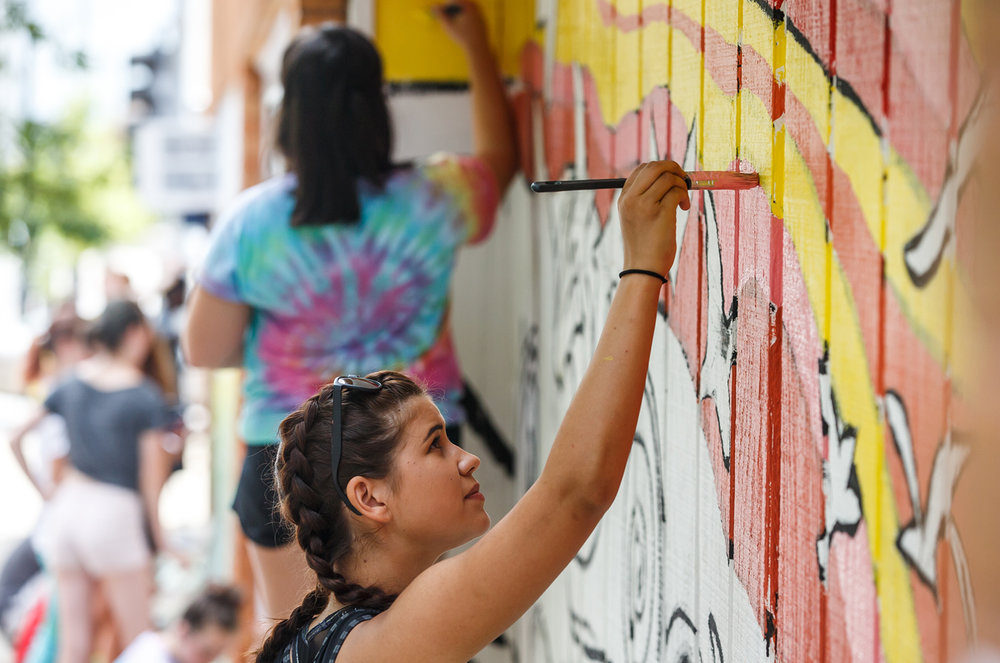 "Kierra Harris, 18, of Petersburg, Ill., works on one for panels of a mural representing the poem ""A Net to Snare the Moon"" by Vachel Lindsay for the Springfield Art AssociationÕs Public Art class for along the eastern wall of a building on North 4th Street and East Jefferson Street, Thursday, July 27, 2017, in Springfield, Ill. The mural is made up for four panels, each representing a stanza from the poem and is being sponsored by The Villas Downtown Springfield, the owners of the building. [Justin L. Fowler/The State Journal-Register]"