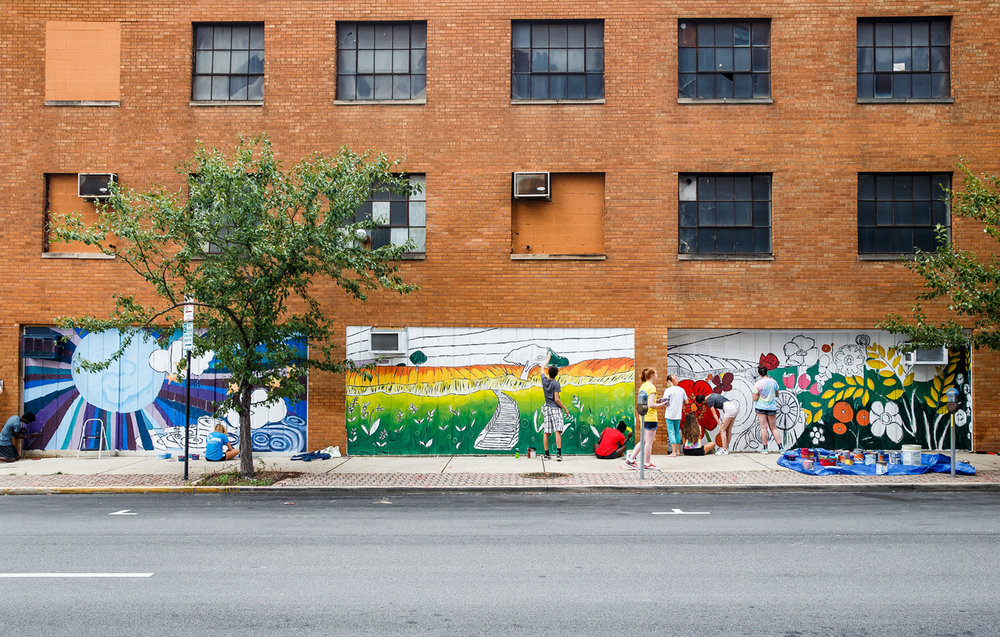 "Erin Svendsen, education coordinator at the Springfield Art Association, designed the mural that is based on the poem ""A Net to Snare the Moon"" by Vachel Lindsay that high schools students from the SAAÕs Public Art Class are painting on the eastern wall of a building on North 4th Street and East Jefferson Street, Thursday, July 27, 2017, in Springfield, Ill. The mural is made up for four panels, each representing a stanza from the poem and is being sponsored by The Villas Downtown Springfield, the owners of the building. [Justin L. Fowler/The State Journal-Register]"