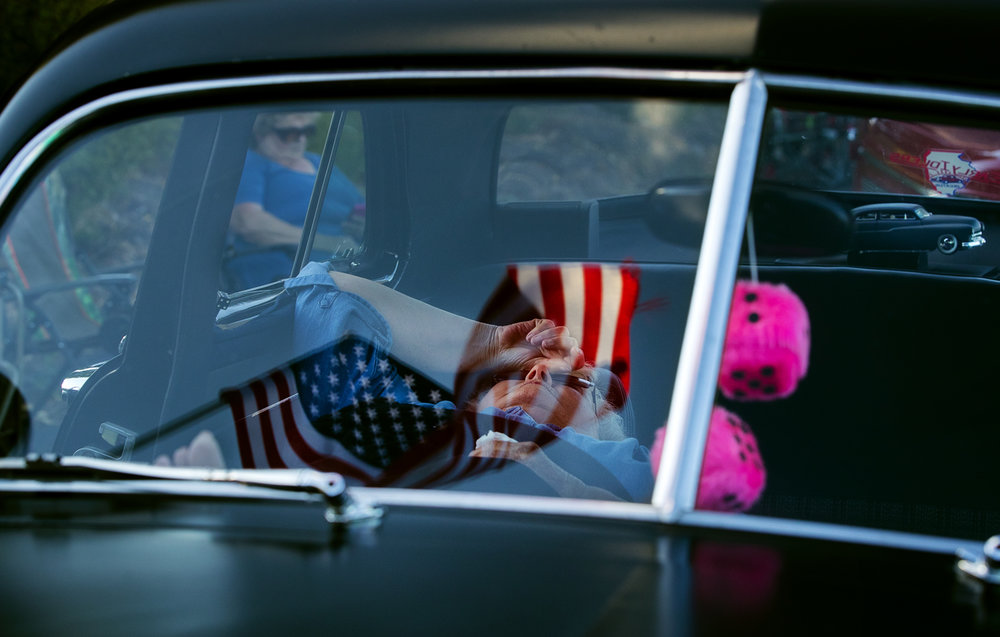 Linda Gregory rests her feet in the passenger seat of her 1951 Mercury during the Powerlight Abe Lincoln Car Show 2017 Cruise Night in downtown Springfield Friday, Aug. 4, 2017. The show continues today at Knight's Action Park. [Ted Schurter/The State Journal-Register]