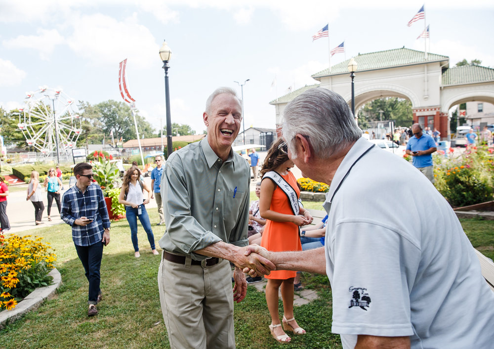Illinois Governor Bruce Rauner visits with patrons inside the Main Gate after the ribbon cutting to officially open the 2017 Illinois State Fair, Thursday, Aug. 10, 2017, in Springfield, Ill. [Justin L. Fowler/The State Journal-Register]