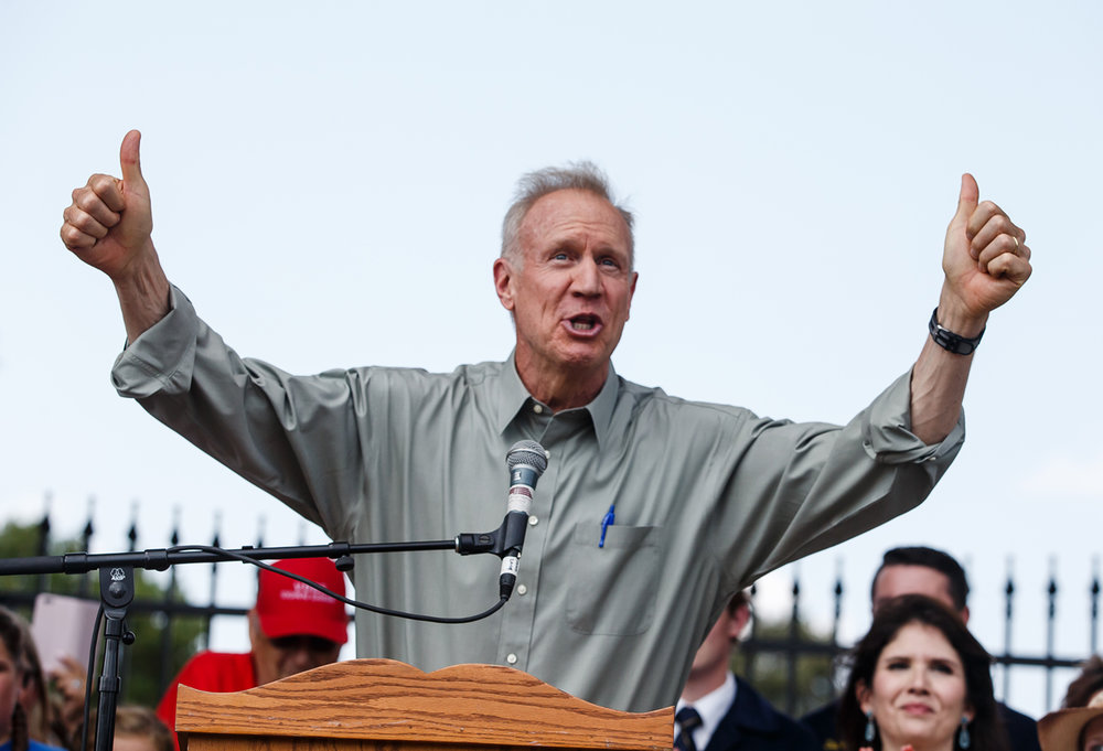 Illinois Governor Bruce Rauner welcomes everyone to the 2017 Illinois State Fair at the Main Gate for the ribbon cutting ceremony, Thursday, Aug. 10, 2017, in Springfield, Ill. [Justin L. Fowler/The State Journal-Register]