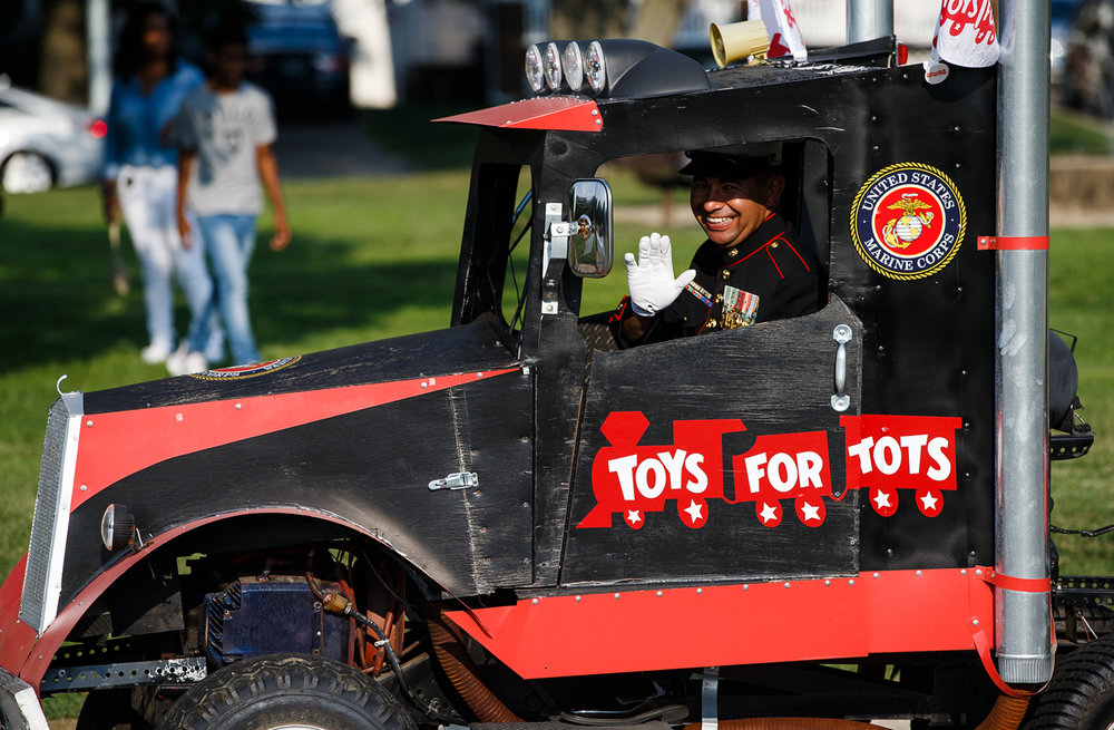 Ret. USMC Gunnery Sgt. Thomas Altevogt pilots the Toys For Tots float inside Lincoln Park along the new route Illinois State Fair Twilight Parade, Thursday, Aug. 10, 2017, in Springfield, Ill. [Justin L. Fowler/The State Journal-Register]
