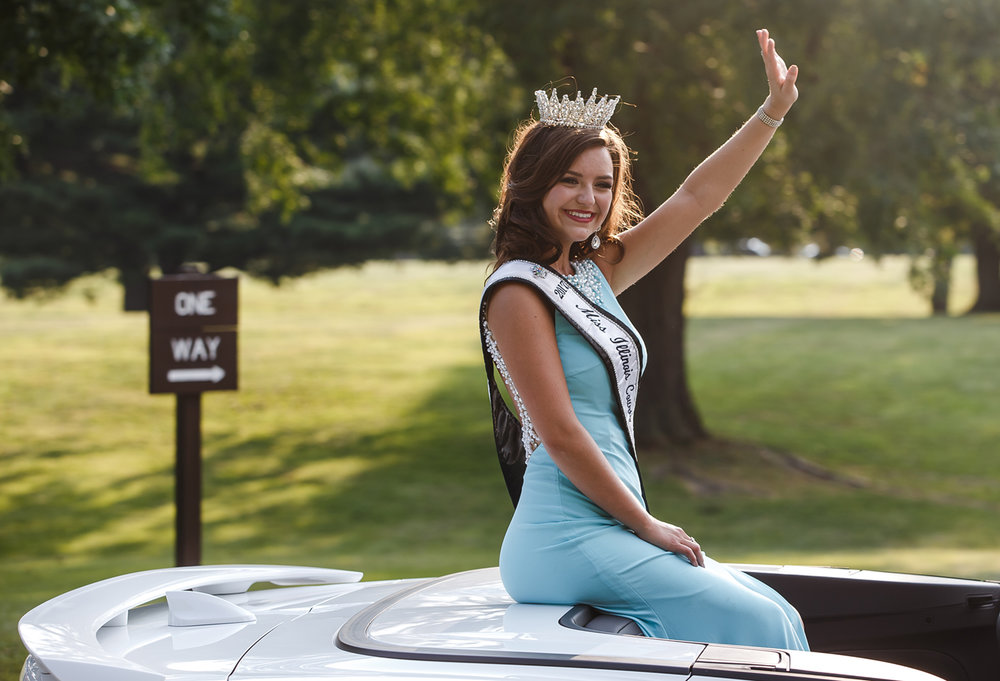 Claudia VanOpdorp, the 2017 Illinois County Fair Queen, makes her way through Lincoln Park along the new route of the Illinois State Fair Twilight Parade, Thursday, Aug. 10, 2017, in Springfield, Ill. [Justin L. Fowler/The State Journal-Register]