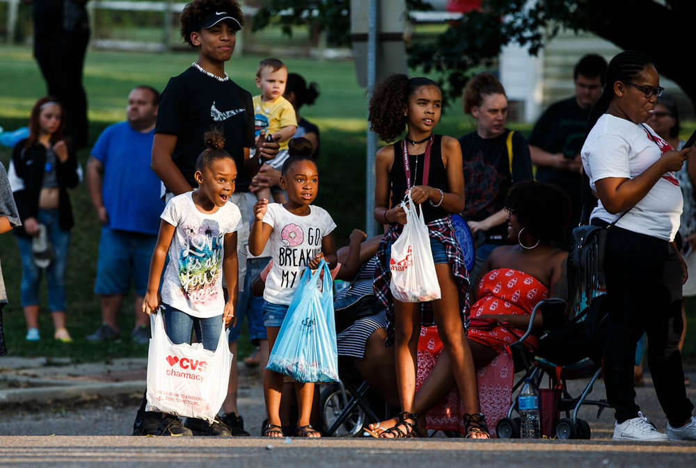 Youth show their excitement as the Springfield High School cheerleading squad make their way down Sangamon Avenue along the new route of the Illinois State Fair Twilight Parade at the Lincoln Park, Thursday, Aug. 10, 2017, in Springfield, Ill. [Justin L. Fowler/The State Journal-Register]