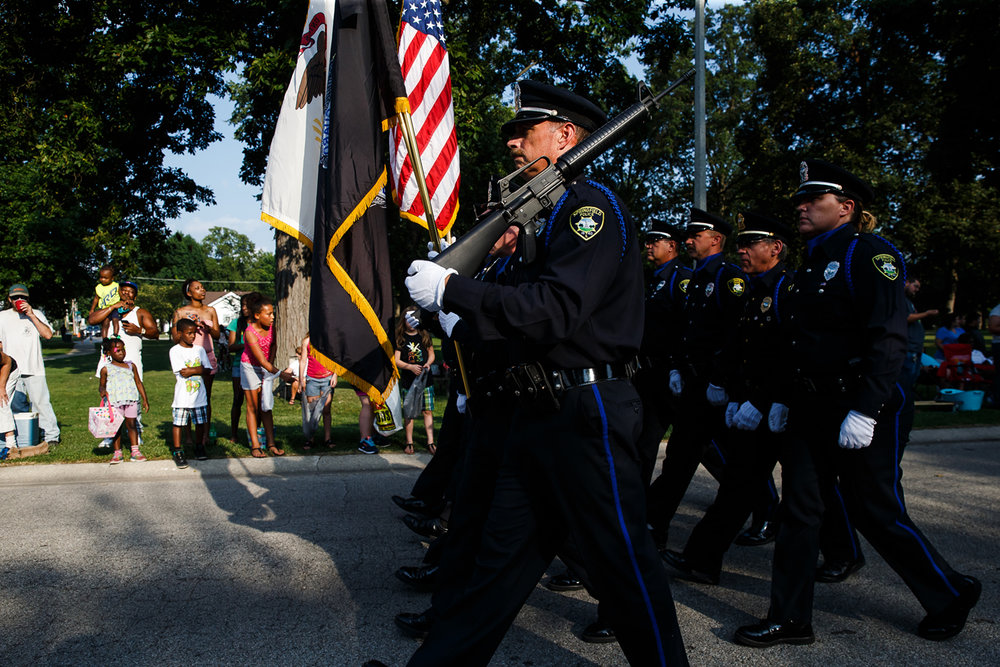 The Springfield Police Department's Honor Guard march in Lincoln Park along the new route of the Illinois State Fair Twilight Parade, Thursday, Aug. 10, 2017, in Springfield, Ill. [Justin L. Fowler/The State Journal-Register]
