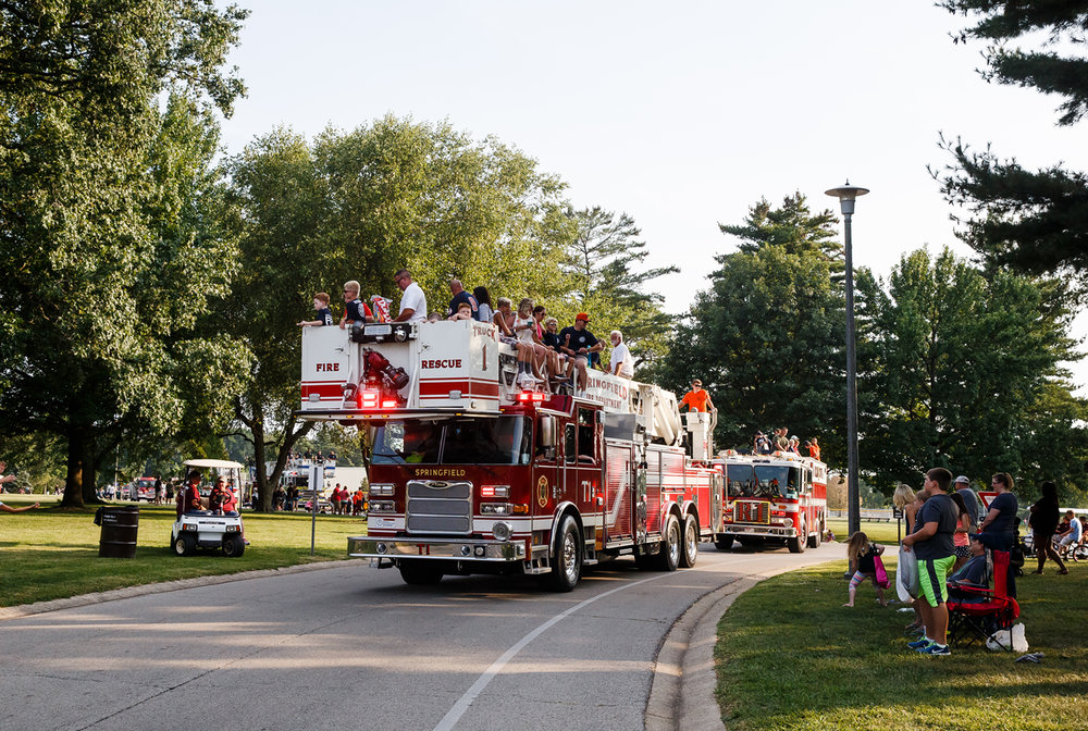 Truck 1 from the Springfield Fire Dept. exits Lincoln Park on to Sangamon Avenue during Illinois State Fair Twilight Parade, Thursday, Aug. 10, 2017, in Springfield, Ill. [Justin L. Fowler/The State Journal-Register]