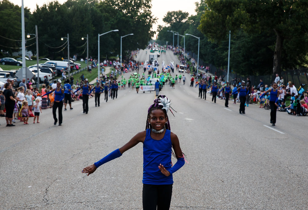 Destiny Bright, 10, leads the Harvey Blue Angels up Sangamon Avenue towards the Main Gate along the new route of the Illinois State Fair Twilight Parade, Thursday, Aug. 10, 2017, in Springfield, Ill. For years, the parade started at North Grand and headed north along Ninth Street and Peoria Road toward the fairgrounds. This year, it started at Lincoln Park and headed east along Sangamon Avenue to the fairgrounds. [Justin L. Fowler/The State Journal-Register]