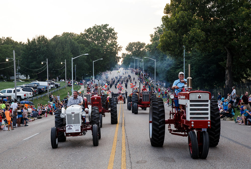 Antique tractors make their way east along Sangamon Avenue along the new route of the Illinois State Fair Twilight Parade, Thursday, Aug. 10, 2017, in Springfield, Ill. [Justin L. Fowler/The State Journal-Register]