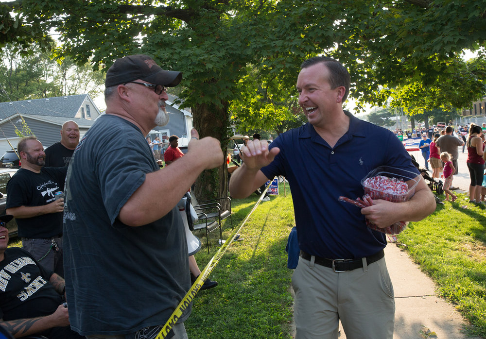 Illinois State Sen. Andy Manar, D-Bunker Hill, works the sidelines as he marches in the Illinois State Fair Twilight Parade along the new route on Sangamon Avenue, Thursday, Aug. 10, 2017, in Springfield, Ill. [Justin L. Fowler/The State Journal-Register]