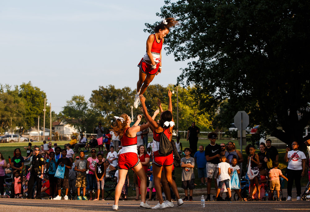 The Springfield High School cheerleading squad performs along Sangamon Avenue on the new route of Illinois State Fair Twilight Parade, Thursday, Aug. 10, 2017, in Springfield, Ill. [Justin L. Fowler/The State Journal-Register]