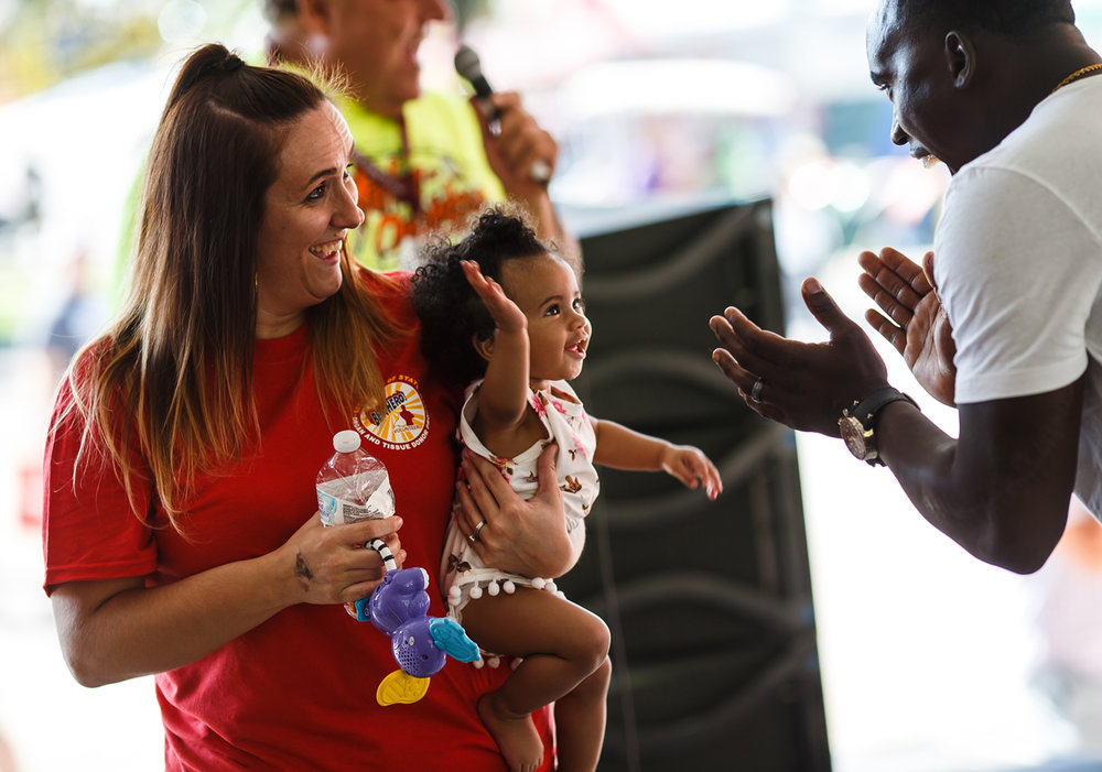 Nylah Taylor, 8-months, is congratulated by her father, Printess Traylor, right, and her mother Bianca Traylor, left, after winning the Diaper Derby at the Illinois State Fairgrounds, Saturday, Aug. 12, 2017, in Springfield, Ill. [Justin L. Fowler/The State Journal-Register]