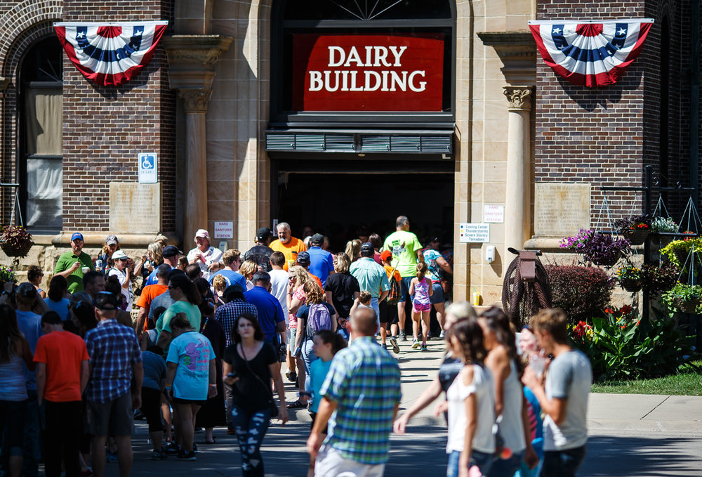 Long lines form outside the Dairy Building to see the Butter Cow as nice weather and the first weekend of the 2017 Illinois State Fair lead to big crowds at the Illinois State Fairgrounds, Saturday, Aug. 12, 2017, in Springfield, Ill. [Justin L. Fowler/The State Journal-Register]