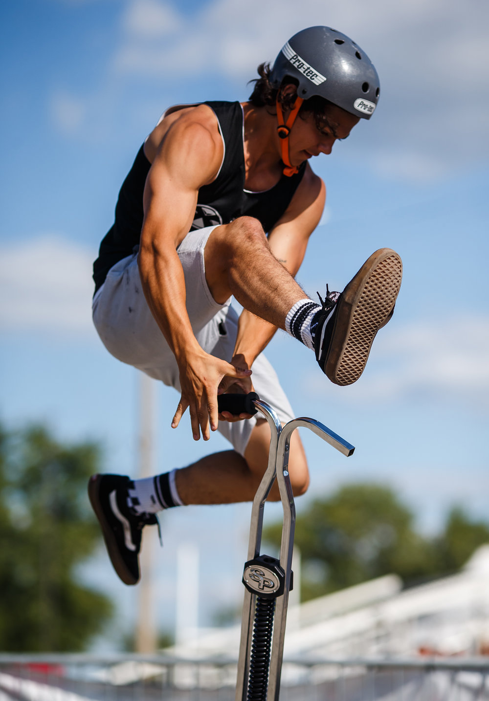 Nic Patino, 19, of New Hope, Penn., moves his leg over a pogo stick while switching hands in mid-air as he performs Xpogo Stunt Team in the Thrillville area near Gate 2 at the Illinois State Fairgrounds, Saturday, Aug. 12, 2017, in Springfield, Ill. [Justin L. Fowler/The State Journal-Register]