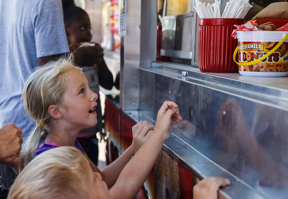Makena Harbauer, 6, and her brother Greydon Harbauer, 4, eagerly await their first order of mini doughnuts for this year's Illinois State Fair at the Illinois State Fairgrounds, Saturday, Aug. 12, 2017, in Springfield, Ill. [Justin L. Fowler/The State Journal-Register]