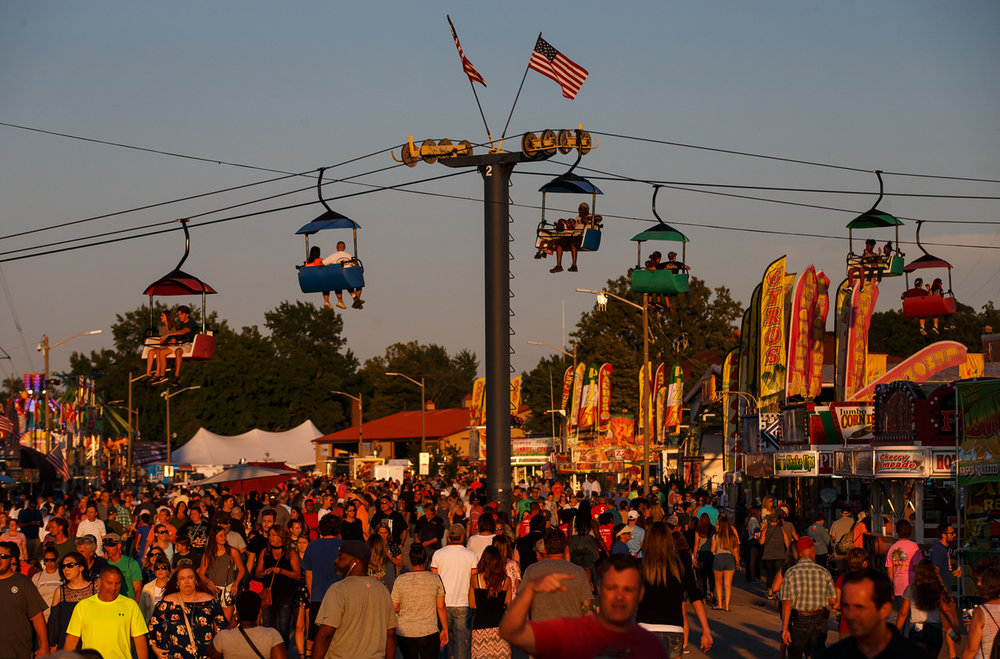 A Saturday with nice weather on the opening weekend o of the Illinois State Fair led to a packed Illinois Avenue at the Illinois State Fairgrounds, Saturday, Aug. 12, 2017, in Springfield, Ill. [Justin L. Fowler/The State Journal-Register]