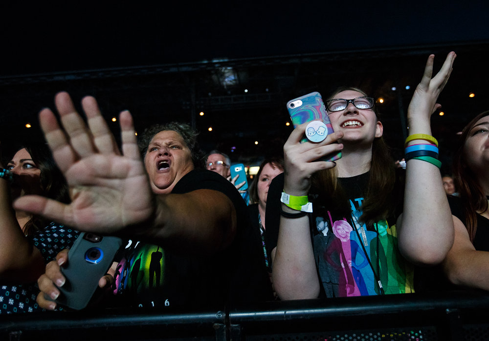"Christine Task, left, and her daughter Sarah Task, of Footville, Wisc., sing along as Pentatonix perform ""Cracked"" on the Grandstand stage at the Illinois State Fairgrounds, Saturday, Aug. 12, 2017, in Springfield, Ill. [Justin L. Fowler/The State Journal-Register]"