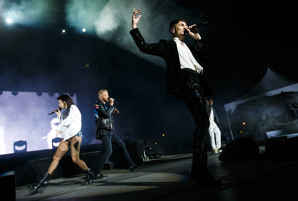 Singer Mitch Grassi, right, performs with his fellow singers of Pentatonix on the Grandstand stage at the Illinois State Fairgrounds, Saturday, Aug. 12, 2017, in Springfield, Ill. [Justin L. Fowler/The State Journal-Register]