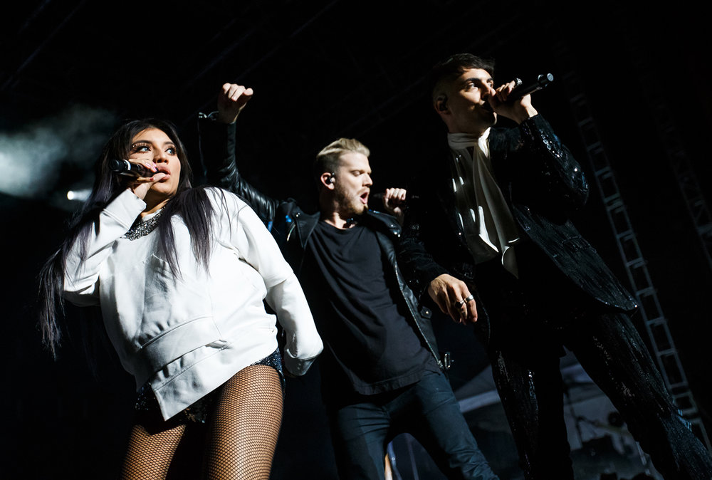 "Singers Kirstin Maldonado, Scott Hoying and Mitch Grassi, of Pentatonix perform ""Cracked"" on the Grandstand stage at the Illinois State Fairgrounds, Saturday, Aug. 12, 2017, in Springfield, Ill. [Justin L. Fowler/The State Journal-Register]"