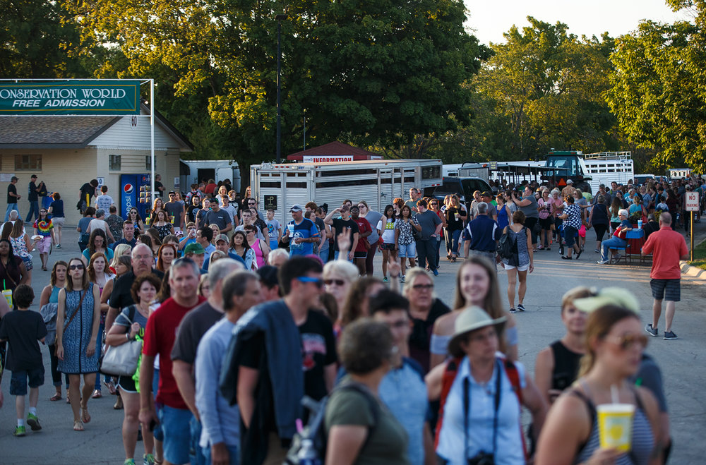 A long line of concert goers forms as they wait to see Pentatonix perform on the Grandstand stage at the Illinois State Fairgrounds, Saturday, Aug. 12, 2017, in Springfield, Ill. [Justin L. Fowler/The State Journal-Register]