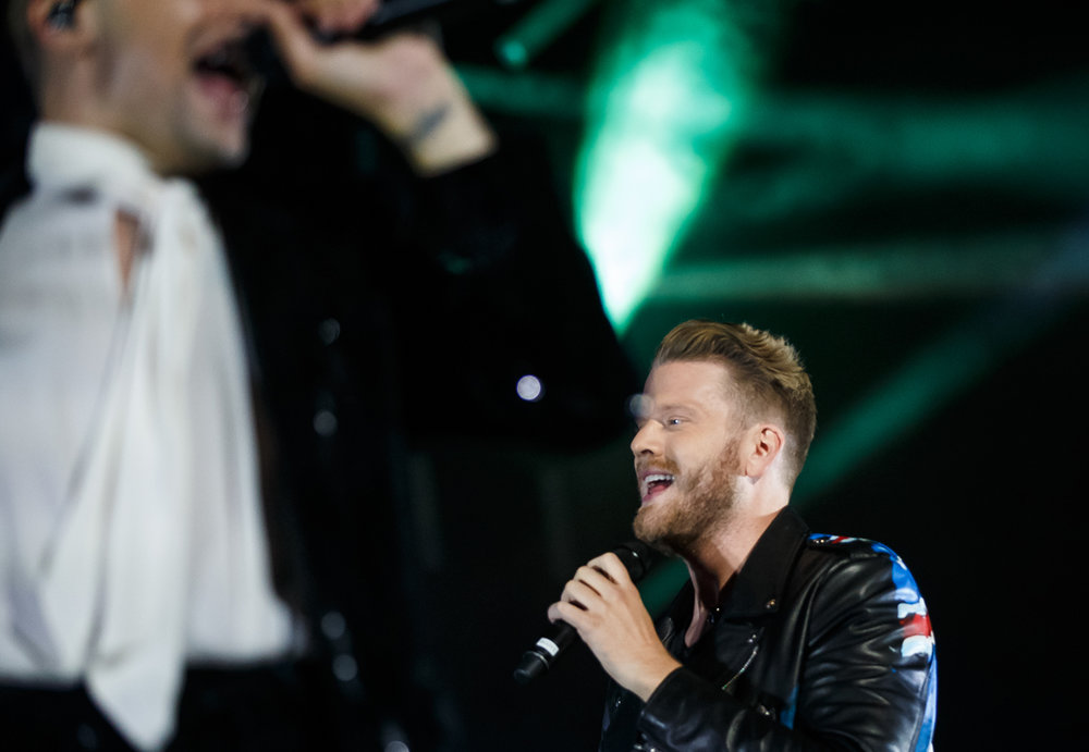 Singers Scott Hoying, center, and Mitch Grassi, left, of Pentatonix perform with the group on the Grandstand stage at the Illinois State Fairgrounds, Saturday, Aug. 12, 2017, in Springfield, Ill. [Justin L. Fowler/The State Journal-Register]