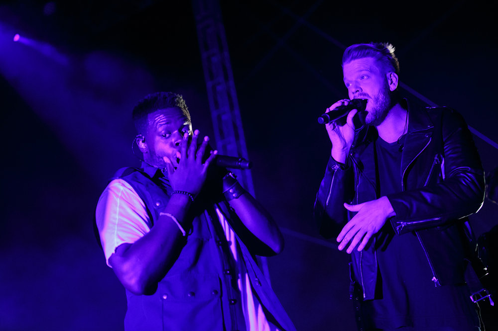 Singers Kevin Olusola, left, and Scott Hoying, right, of Pentatonix perform on the Grandstand stage at the Illinois State Fairgrounds, Saturday, Aug. 12, 2017, in Springfield, Ill. [Justin L. Fowler/The State Journal-Register]