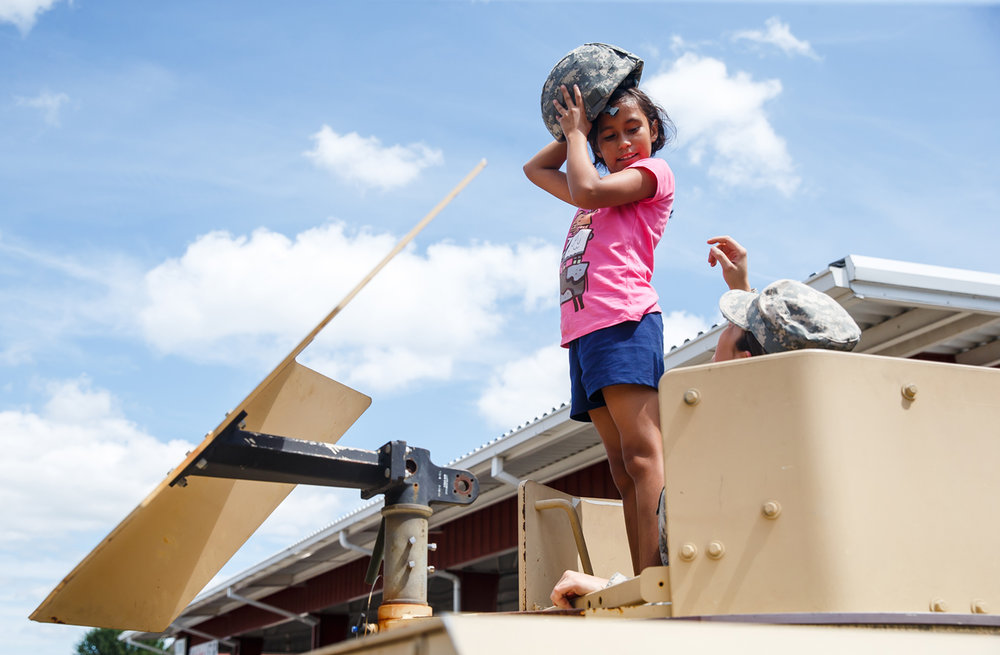 Aricia Forylane, 9, gets a birds eye view from the turret of humvee on display during the Veterans and Gold Star Family Day at the Illinois State Fairgrounds, Sunday, Aug. 13, 2017, in Springfield, Ill. [Justin L. Fowler/The State Journal-Register]