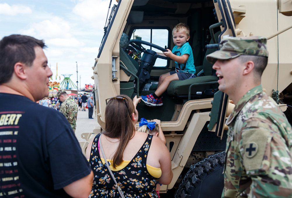 Max McKinney, 3, tries out the drivers seat of a Light Motor Transportation Vehicle on display during the Veterans and Gold Star Family Day at the Illinois State Fairgrounds, Sunday, Aug. 13, 2017, in Springfield, Ill. [Justin L. Fowler/The State Journal-Register]