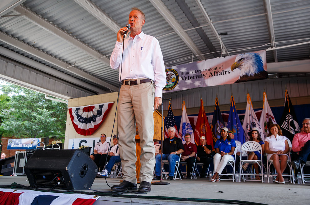 Illinois Governor Bruce Rauner delivers his remarks during the Veterans and Gold Star Family Day from the Lincoln Stage at the Illinois State Fairgrounds, Sunday, Aug. 13, 2017, in Springfield, Ill. [Justin L. Fowler/The State Journal-Register]