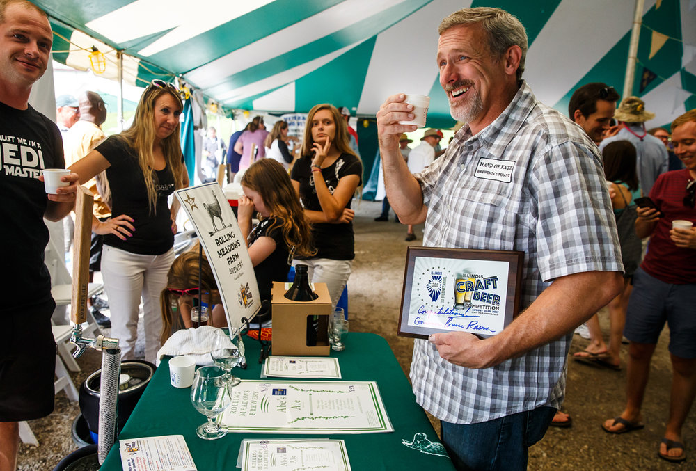 "Mike Allison, of Hand of Fate Brewing Company out of Petersburg, Ill., celebrates after his ""What the Fuzz"" craft beer won the Illinois Bicentennial Craft Beer Competition during the 2017 Illinois State Fair on the Illinois State Fairgrounds, Sunday, Aug. 13, 2017, in Springfield, Ill. [Justin L. Fowler/The State Journal-Register]"