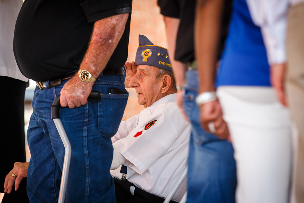 George Pempek, a U.S. Army Veteran of WWII, the Korean War and the Vietnam War, salutes as the National Anthem is played during the Veterans and Gold Star Family Day on the Lincoln Stage at the Illinois State Fairgrounds, Sunday, Aug. 13, 2017, in Springfield, Ill. [Justin L. Fowler/The State Journal-Register]