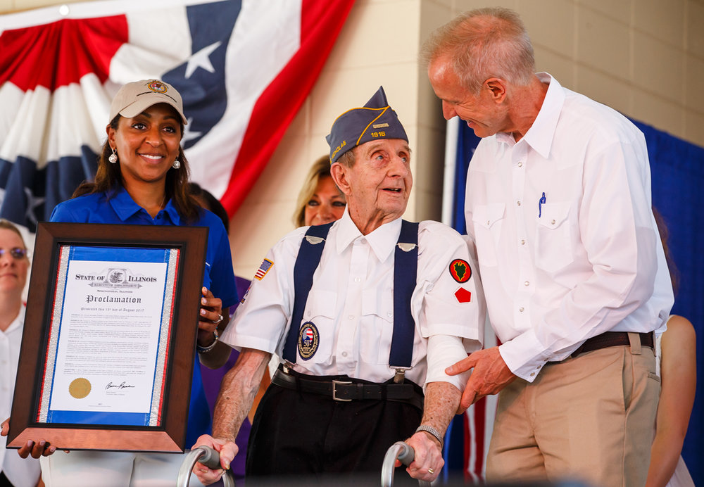 George Pempek, a U.S. Army Veteran of WWII, the Korean War and the Vietnam War, is honored with the Illinois Veterans' Patriotic Volunteer of the Year award by Illinois Governor Bruce Rauner and Illinois Dept. of Vetarans' Affairs director Erica Jeffries during the Veterans and Gold Star Family Day on the Lincoln Stage at the Illinois State Fairgrounds, Sunday, Aug. 13, 2017, in Springfield, Ill. [Justin L. Fowler/The State Journal-Register]