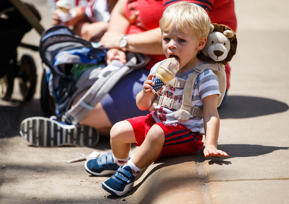 Kyle Ferguson, 2, of Maryville, Ill., enjoys an ice cream cone outside the Dairy Building at the Illinois State Fairgrounds, Sunday, Aug. 13, 2017, in Springfield, Ill. [Justin L. Fowler/The State Journal-Register]