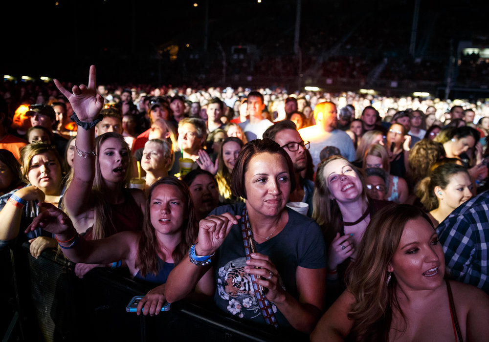 Fans sing along as Brad Paisley performs on the Grandstand stage for a stop on his Life Amplified World Tour at the Illinois State Fairgrounds, Sunday, Aug. 13, 2017, in Springfield, Ill. [Justin L. Fowler/The State Journal-Register]