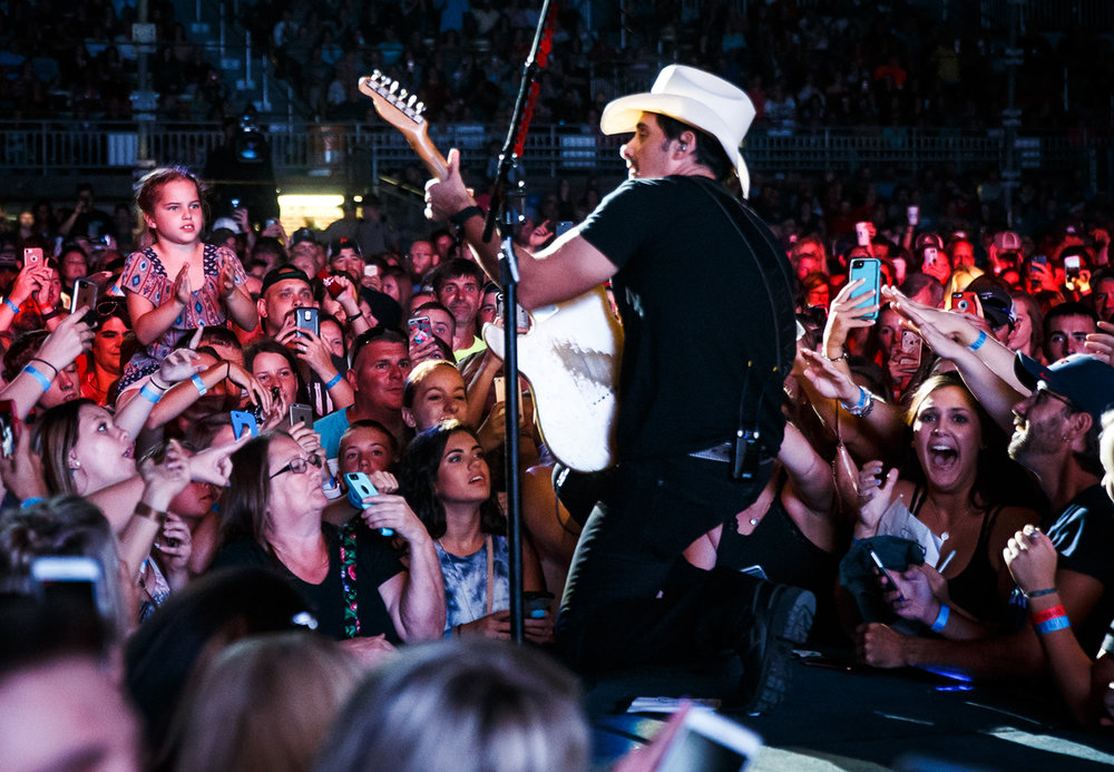 Fans get a close up view of Brad Paisley as he performs on the Grandstand stage for a stop on his Life Amplified World Tour at the Illinois State Fairgrounds, Sunday, Aug. 13, 2017, in Springfield, Ill. [Justin L. Fowler/The State Journal-Register]