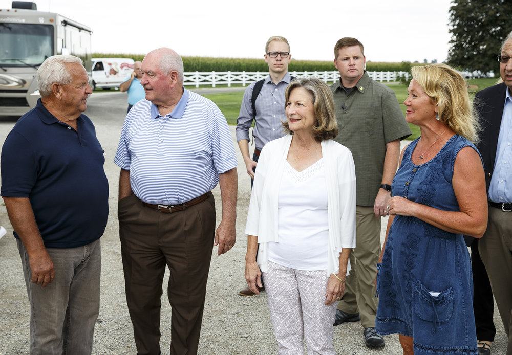 U.S. Secretary of Agriculture Sonny Perdue and his wife Mary arrive at Beaty Farm near Berry Monday, Aug. 7, 2017 during a stop on a five-state tour to gather input from farmers for the 2018 farm bill. The stop was hosted by Larry Beaty, left, and his wife Diana, right. [Rich Saal/The State Journal-Register]