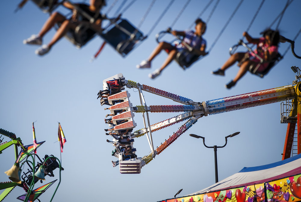"The ""Freak Out"" carnival ride spins riders around as it swings back and forth soaring over the midway at the Illinois State Fairgrounds, Friday, Aug. 11, 2017, in Springfield, Ill. The ""Freak Out"" is similar to a ride that was involved in a fatal accident at the Ohio State Fair last month, Illinois officials took extra precautions to inspect the ride to ensure that it is safe. [Justin L. Fowler/The State Journal-Register]"