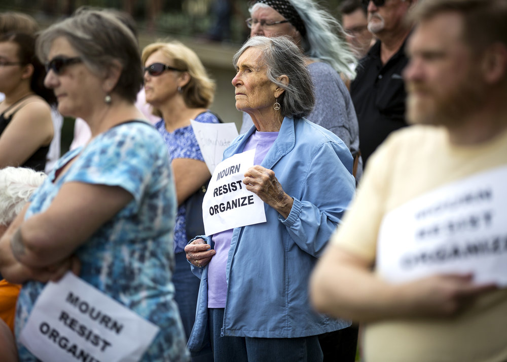Peggy Knoepfle listens to speakers at a vigil for the victims of the protests in Charlottesville, Va. Sunday, Aug. 13, 2017 outside Springfield's municipal center. [Rich Saal/The State Journal-Register]