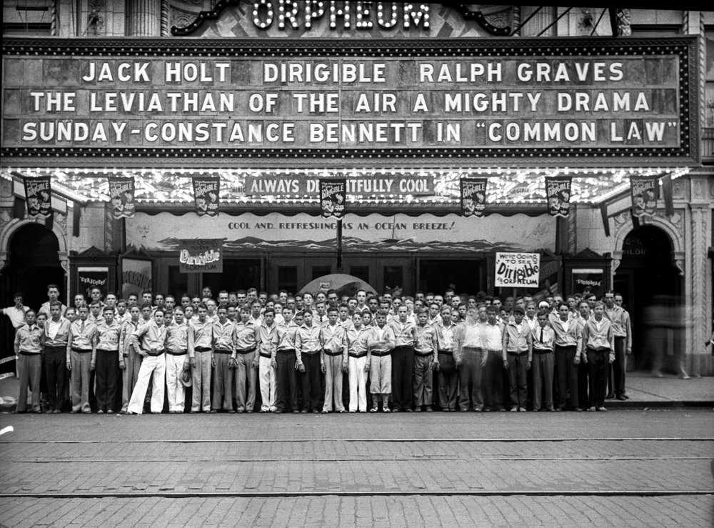 "Group photo of news carriers, (""Carrier Boys Enjoy Movie""), Orpheum Theater marquee, pub. ISJ 8-20-1931, p.16. Illinois State Register glass plate negative/Sangamon Valley Collection at Lincoln Library  C-98-1063, neg. #1187.