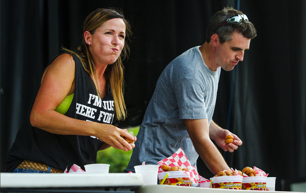Michelle Severino smiles as she glances over at her family in the crowd during the 2017 Illinois State Fair Competitive Food Eating Contest Monday, Aug. 14, 2017. Severino won the contest after devouring 1.352 pounds of donuts.[Ted Schurter/The State Journal-Register]