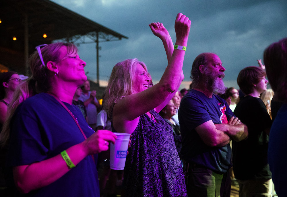 Fans on the track during the Herman's Hermits concert at the Illinois State Fair Monday, Aug. 14, 2017. [Ted Schurter/The State Journal-Register]