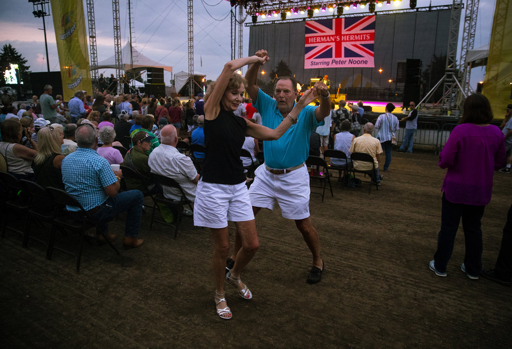 Cathy and Les and Hohenstein dance on the track during the Herman's Hermits concert at the Illinois State Fair Monday, Aug. 14, 2017. [Ted Schurter/The State Journal-Register]