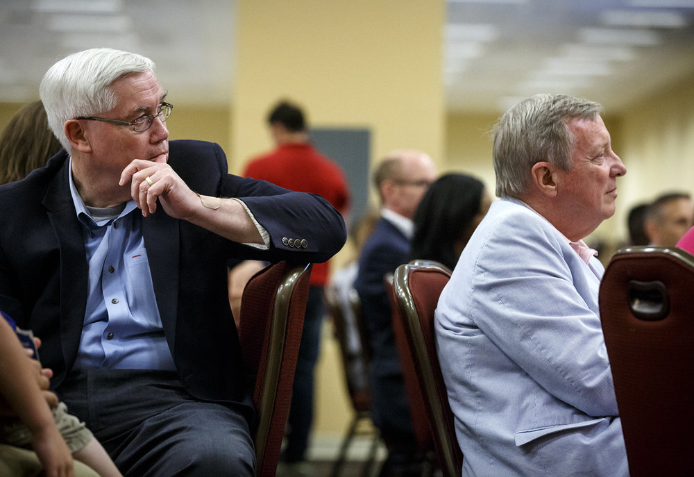 Democratic State Central Committeeman Bill Houlihan, left, and U.S. Sen. Dick Durbin listen to the keynote address by U.S. Sen. Amy Klobuchar, D-Minnesota, at the Illinois Democratic County Chairmen's Association 2017 Annual Chairmen's Brunch Thursday Aug. 16, 2017 at the Crowne Plaza in Springfield, Ill. [Rich Saal/The State Journal-Register]